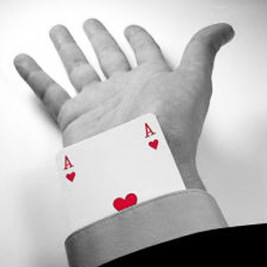 An Ace of Hearts card protruding from the end of a business person's sleeve