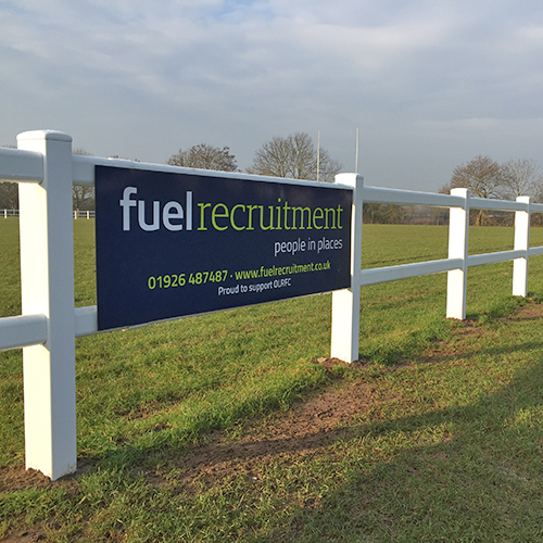Fuel Recruitment logo on a banner on a white fence