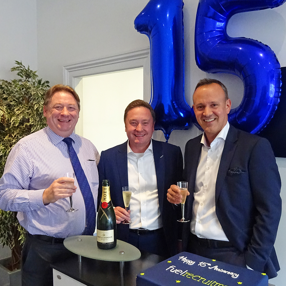Mark Esom, Steve Willmore and Murray West celebrate 15 years of Fuel Recruitment with champagne, cake and balloons